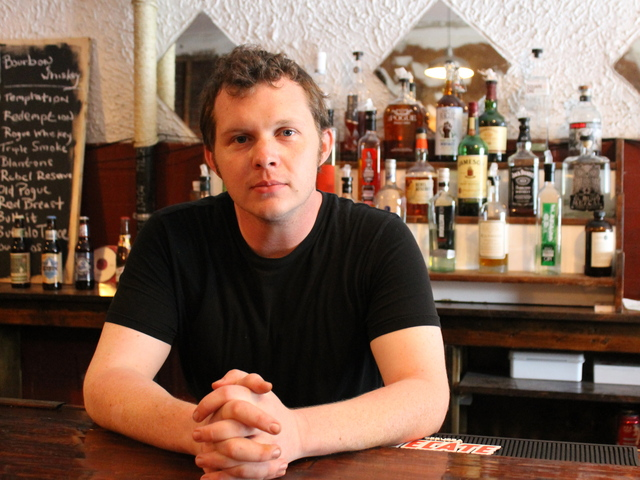 Chef Nick Gilbert stood at the bar of the new Southern eatery Mama Joy's.