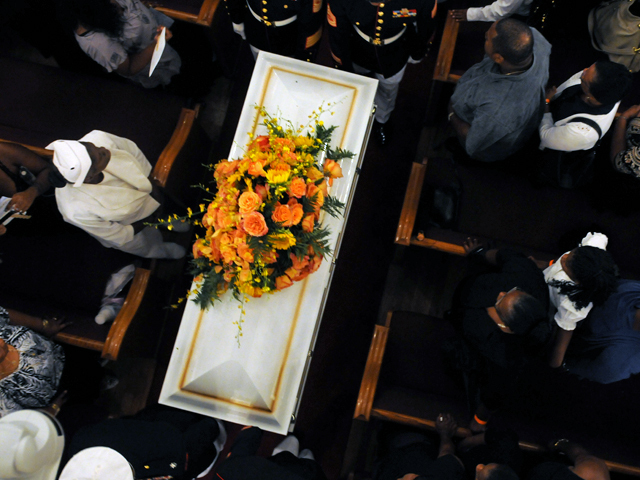 <p>A white coffin was carried out of the church during the funeral for 4-year-old Lloyd Morgan, who was killed by a stray bullet in a Bronx playground, Aug. 1, 2012.</p>
