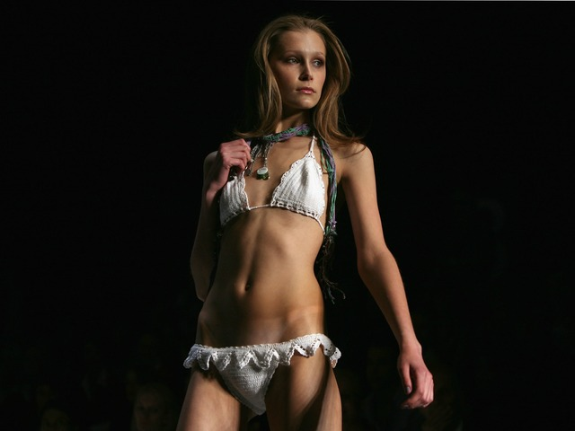 SYDNEY, AUSTRALIA - APRIL 29: A model showcases designs by Kini Bikini as part of the Swim Group Collection Show on the catwalk at the Overseas Passenger Terminal, Circular Quay on day three of Rosemount Australian Fashion Week Spring/Summer 2009/10 on April 29, 2009 in Sydney, Australia.