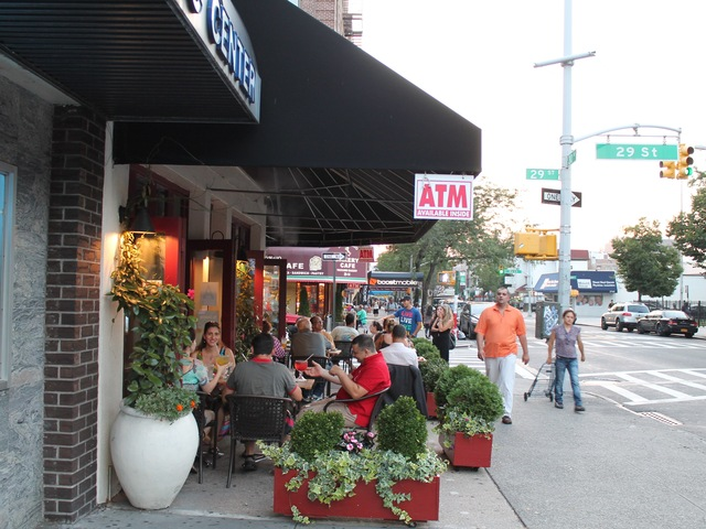 The number of sidewalk cafes in Astoria keeps growing.