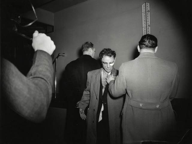 Weegee, [Anthony Esposito, booked on suspicion of killing a policeman, New York], January 16, 1941.
