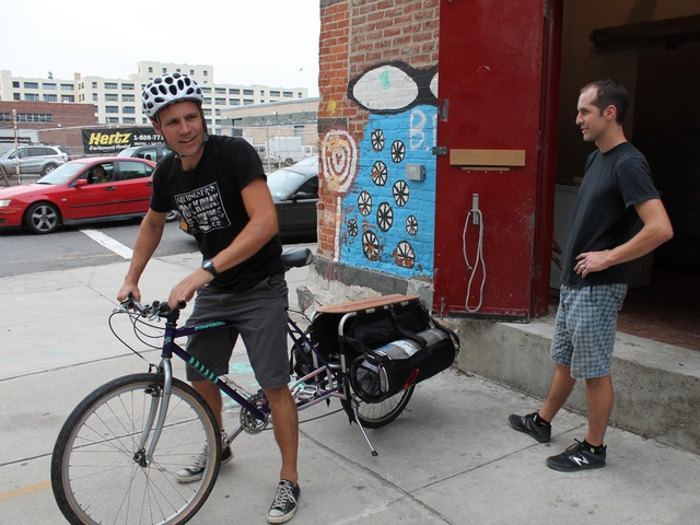 Marcus Burnett delivers beer on a custom made beer bike, built by Recycle-A-Bicycle.