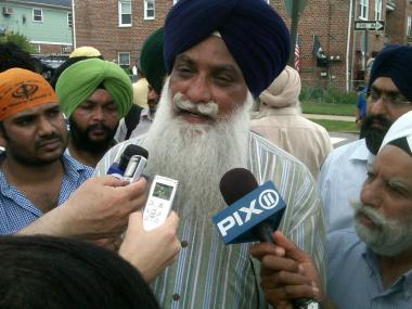 Mohan Singh Khara, whose uncle was killed in the Wisconsin shooting, spoke to reporters Aug. 6, 2012.