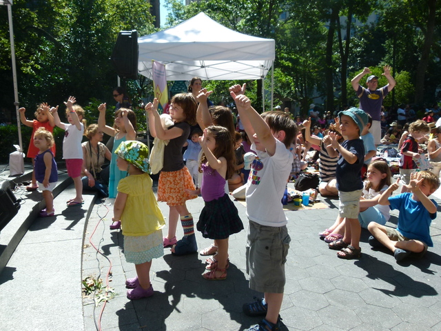 Fist-pumping kids show their appreciation for Bari Koral at Madison Square Park.