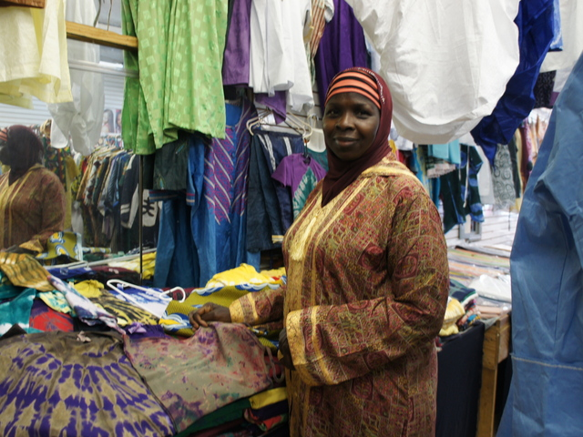 Kadija Tunkara shows off her wares at Badugula Tye Dye African Creation on Fulton Street in Bed-Stuy.