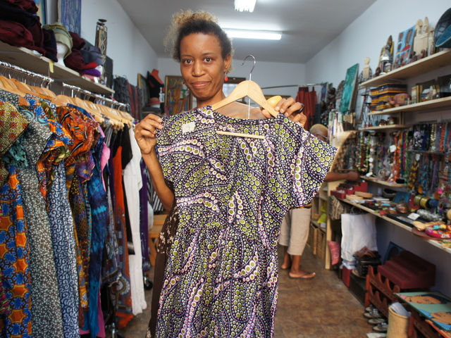 Calabar Imports owner Atim Oton shows off her boutique's unique line of Nigerian cotton dresses.