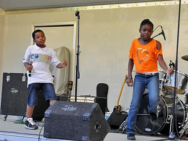 "Brother and sister Tayahna, 10, and Kyron, 9, Walcott, who both live in Brownsville, perform a song called ""Stop Bullying."""