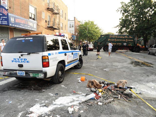 Debris from the crash littered the street Wednesday, Aug. 8, 2012.