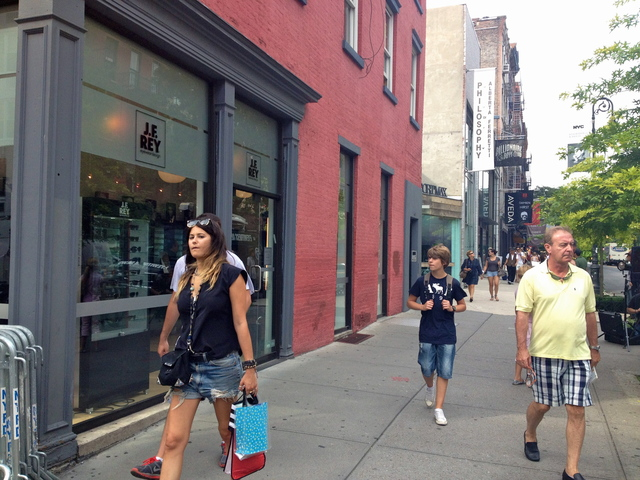 Shoppers and tourists walk past the West Broadway location of a former bodega where Etan Patz confessed killer Pedro Hernandez worked.