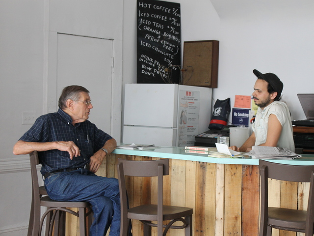 Molasses' owner Matthew Winn chatted with longtime Bushwick business owner Marvin Mann.