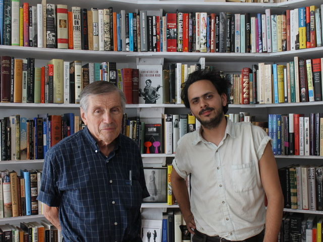 Matthew Winn and Marvin Mann stood among the stacks of Molasses Books, Winn's new shop.