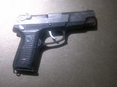 This Ruger 9mm handgun was found near the scene of the shootout.