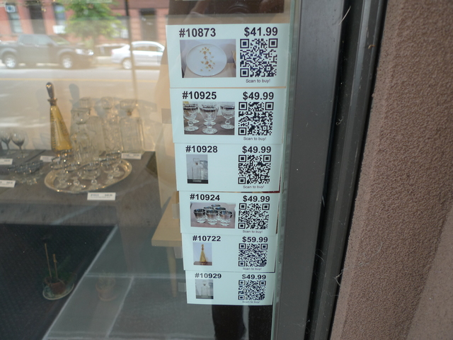 Customers at Robert Henry Vintage use QR codes to shop for items they like in the window display.