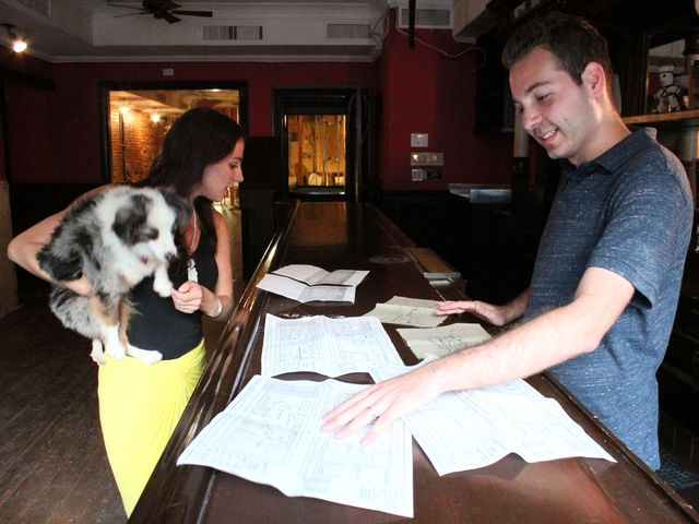 <p>Alexia Simon Frost and Danny Frost look over the plans for Ruff Club&#39;s location on 34 Avenue A.</p>