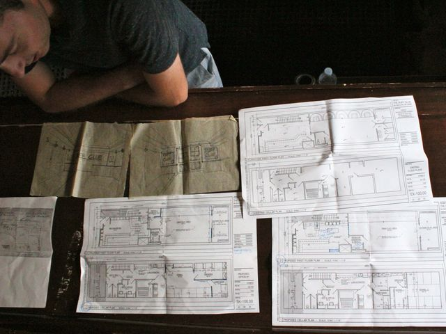 <p>Danny Frost looks over the plans for Ruff Club&#39;s location on 34 Avenue A.</p>