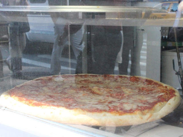 Many spots along Eighth Avenue serve up discount $1 slices of pizza.