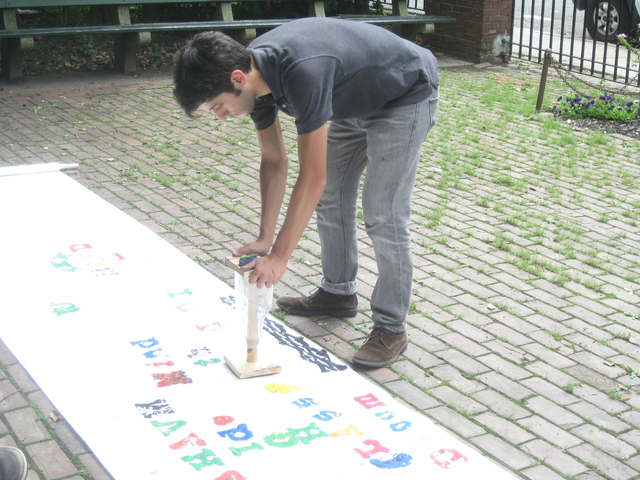 A public art project, SMASH Type, let people become human keys and bash a letter onto a sheet of paper to create a collaborative poem.