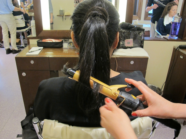 Once the ponytail is secured, Pak slightly curls the ends.