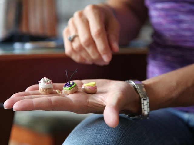 Amy Milstein, 45, shows the Fimo pieces her 12-year-old daughter makes and sells online.