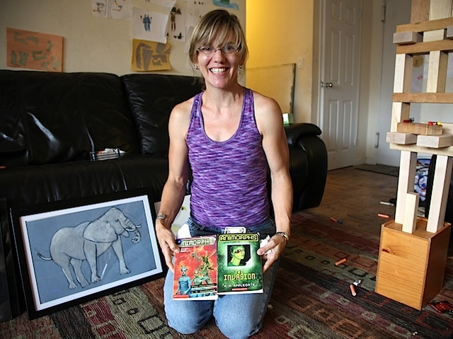 Home school mother Amy Milstein shows the books her 8-year-old son enjoys reading.