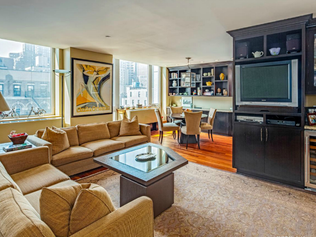 The living room  of a 2-bedroom, 2.5-bathroom apartment at the Seville, 300 East 77th Street, 6B on the Upper East Side, listed for $1.849 million by Prudential Douglas Elliman.