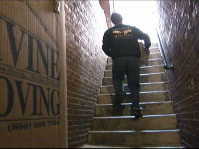 Moving experts, like Divine Moving & Storage (pictured), suggest making sure you have a bag of clothes ready in case the apartment isn't ready.