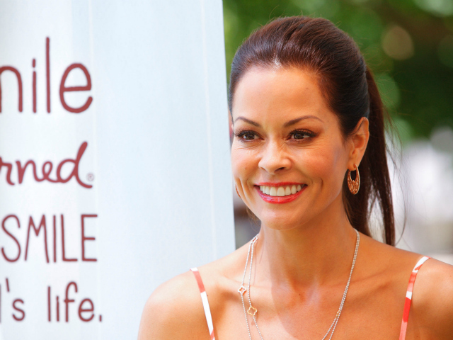 "Brooke Burke, co-host of ""Dancing with the Stars,"" opts for a sleek ponytail style."