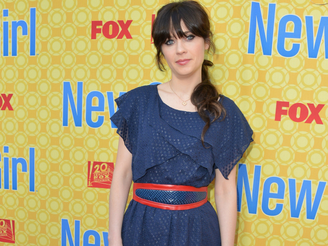 "Zooey Deschanel, star of the NBC show ""New Girl,"" sports a ponytail for a promotional event."