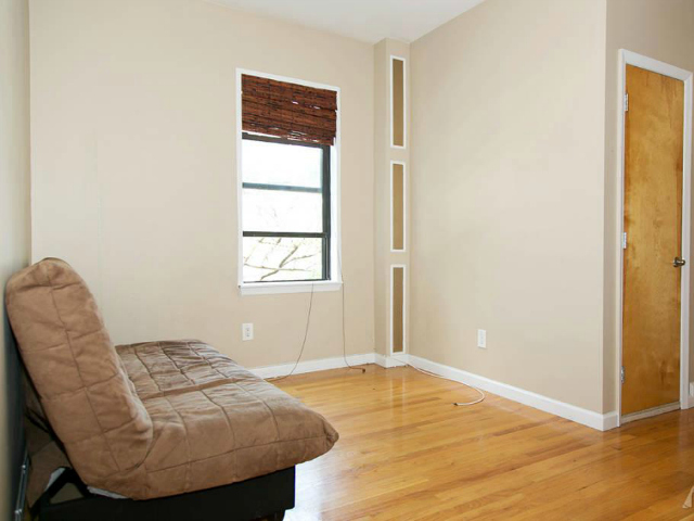 The living room at 21-37 33rd St., #3E, listed for $280,000 by Modern Spaces.