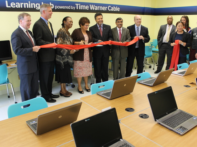 Elected officials, Time Warner Cable representatives, and employees and clients of Good Shepherd Services gathered to celebrate the nonprofit's new computer lab.
