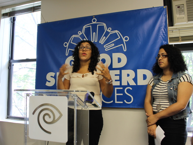 Marisol Zacarias of Good Shepherd Services talks about the nonprofit's new computer lab as 19-year-old Chastity Polanco, a Good Shepherd client, looks on.