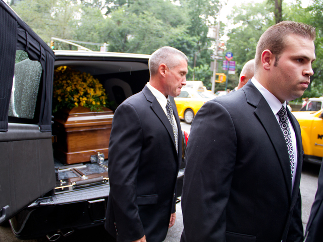 Pall bearers load  the casket of Marvin Hamlisch Aug. 14 into the hearse from the  Temple Emanu-El at 65th Street and 5th Avenue on the Upper East Side.