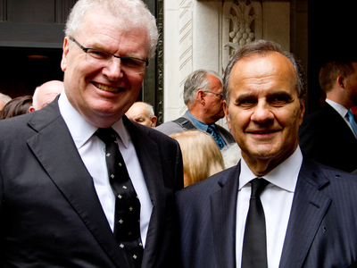 <p>Sir Howard Stringer (left) a good friend of Marvin Hamlisch, poses for a picture outside of Temple Emanu-El at 65th Street and 5th Avenue after the funeral of Hamlisch Aug. 16.</p>