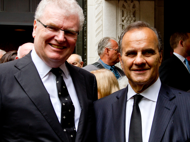 Sir Howard Stringer (left) a good friend of Marvin Hamlisch, with Joe Torre, poses for a picture outside of Temple Emanu-El at 65th Street and Fifth Avenue after the funeral of Hamlisch Aug. 16.
