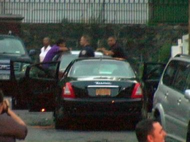 Police inspect a stolen Maserati in Cypress Hills, Brooklyn, after the vehicle was carjacked in Hollis, Queens, Tuesday, Aug. 14, 2012.