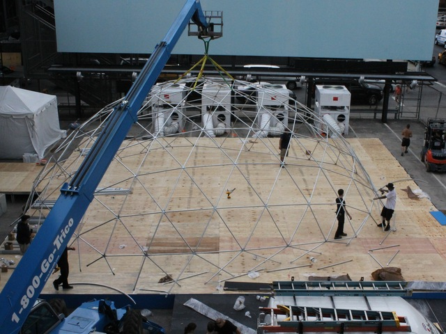 Workers set up a giant snow globe under the High Line as part of Jaguar's ChillNY.