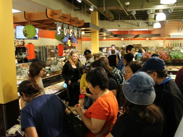 Crowds of shoppers flocked to 55 Fulton Market on its opening day Aug. 15, 2012.