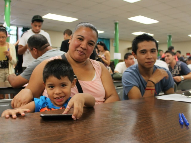 Valeria and her son, Jose, were among those who waited for help. Jose was born in Chile, but grew up in the United States. He hoped the new regulations will help him find a steady job.