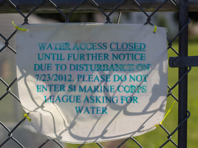 <p>The sign on the fence of the unnamed natural spring on Sunnyside telling water lovers the spring is closed indefinitely.</p>