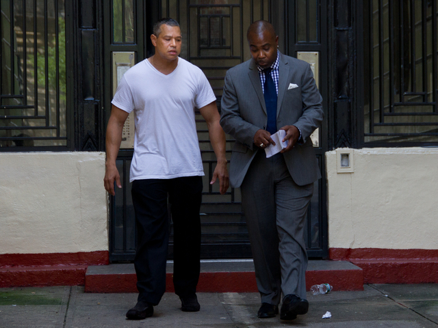 A tenant of 602 W 190th St. walks with a detective out of the building where Armando Bennett, the super of the building, suffered from injuries from an elevator accident. Neighbors say that the tenant dropped his keys in the elevator shaft and Bennett went to retrieve them, which contributed to the injuries.