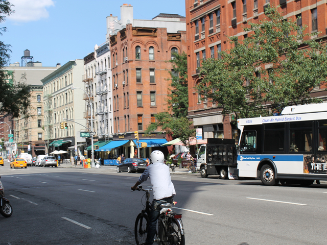 A food-delivery cyclist rides on Amsterdam Avenue on Aug. 16, 2012. The city will ramp up its enforcement of traffic rules for commercial cyclists in January.