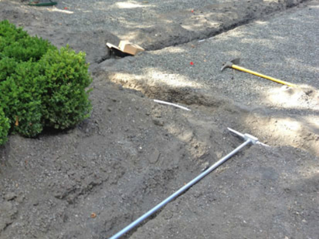 Trenches were dug inside the park to hide wires for the new security cameras in Gramercy Park.