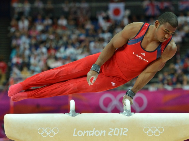 John Orozco performs on the pommel horse during the men's individual all-around competition of the artistic gymnastics event of the London Olympic Games on August 1, 2012 at the 02 North Greenwich Arena in London.