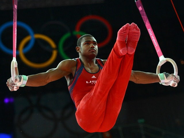 US gymnast John Orozco performs on the rings during the men's individual all-around competition of the artistic gymnastics event of the London Olympic Games on August 1, 2012 at the 02 North Greenwich Arena in London.