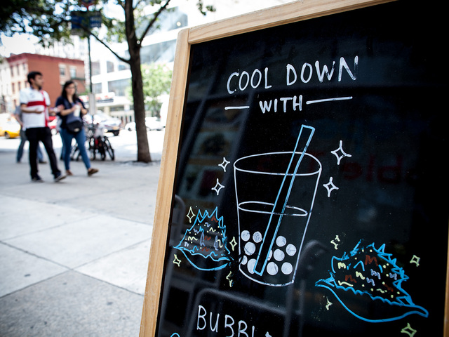 A sign outside Just Sweet tempts New Yorkers to try Bubble Tea, a popular Asian beverage on Aug. 18th, 2012.