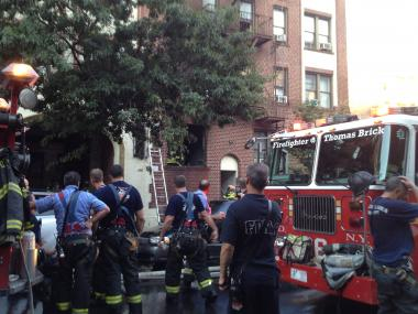 More than 60 firefighters battled a blaze in Inwood Saturday night, officials said.