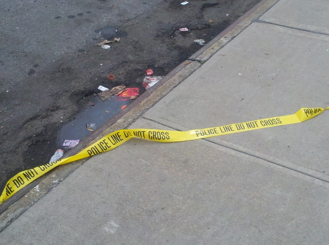 Crime tape outside a McDonald's restaurant at 1625 Webster Ave., in the Bronx, where police found Hansell Arias, 22, after he was stabbed to death on August 19, 2012.