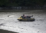 Jet-Skiers Get Stuck in the Mud in New York City
