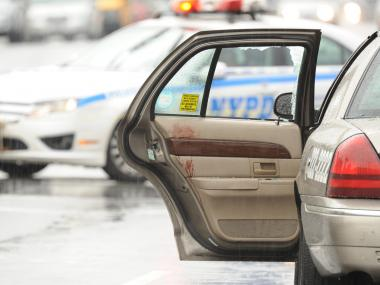 FLATLANDS — A 23-year-old man was shot in the head while riding in the back of a livery cab as a gunman attempted to rob the driver on Utica Avenue and Avenue O in Brooklyn.