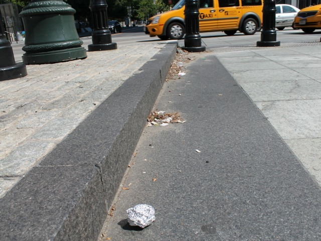 Garbage and cigarette butts are building up at West Street crossings in Lower Manhattan.